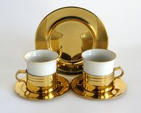 Set of two porcelain cups. In brass holders Royalty Free Stock Photos