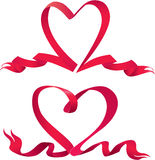 Set of two Red ribbons are made in heart shape. Stock Image