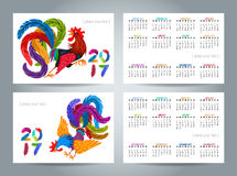 Set of two small calendar templates with colorful roosters. Lettering 2017 made of feathers. Drawing Chinese symbol of the New Year. Decorative abstract cocks Royalty Free Stock Photos