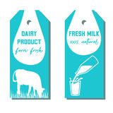 Set of two tags with milk symbol. Cow, Milk pouring from a bottle in glass. Stock Photography