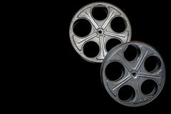 Two vintage film reels on a black background with copy space. A set of two vintage film reels on a black background with copy space stock image