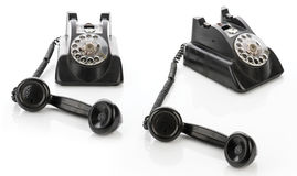 Set of two Vintage telephones isolated on a white background Stock Photography