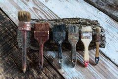 Set używać muśnięcia na drewnianej powierzchni z, retro, i roczniku, kopii przestrzeń Obrazy Royalty Free