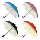Set Umbrellas vector. Set of umbrellas from the rain, open stand on the floor. Blue, red, black and pink. Isolated on white background Vector 3D illustration vector illustration