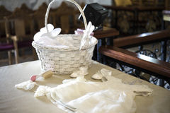 Set up for baptism. The cloth of a baby girl during her baptism Royalty Free Stock Photos