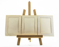Set up easels. A small easel with empty  photo frame Stock Photography