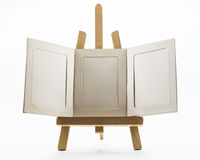 Set up easels. A small easel with empty  photo frame Stock Photos