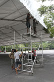Set up tend. Workers were setting up tend for an exhibition in the city of Solo, Central Java, Indonesia stock photo