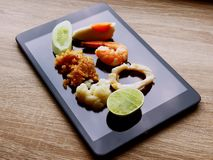 Set up thailand food on tablet royalty free stock photography