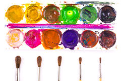 Set of used watercolour paints and paintbrushes Stock Photos