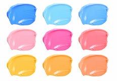 Set uzupełniał kolorów rozmazów pomadkę odizolowywającą na białym tle Obrazy Royalty Free