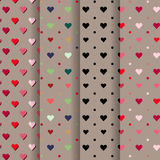 Set of valentine red, blue, pink, hearts on brown background. Stock Photography