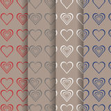 Set of valentine red grey, white, blue heart on brown background. Stock Photos