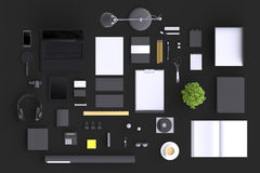 Set of variety blank office objects organized for company presentation or branding identity with blank modern devices. Royalty Free Stock Photography