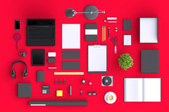 Set of variety blank office objects organized for company presentation or branding identity with blank modern devices. Royalty Free Stock Photo