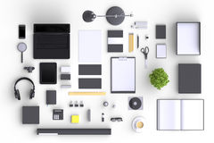 Set of variety blank office objects organized for company presentation or branding identity with blank modern devices. Mockup isolated on clear background. Top Stock Photo