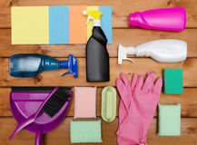 Set of variety cleaning supplies on wooden table Stock Images