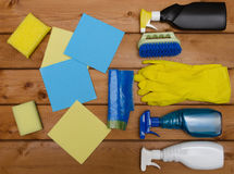 Set of variety cleaning supplies on wooden table Royalty Free Stock Image