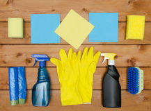 Set of variety cleaning supplies on wooden table Royalty Free Stock Images