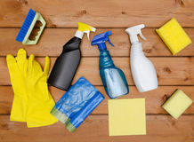 Set of variety cleaning supplies on wooden table Royalty Free Stock Photos
