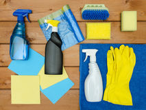 Set of variety cleaning supplies on wooden table Royalty Free Stock Photo