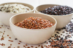 Set of variety of gourmet rice in bowls. Selective focus Stock Photos