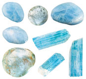 Set of various aquamarine blue beryl minerals. Set of various aquamarine blue beryl mineral crystals and polished gem stones isolated on white background royalty free stock photography