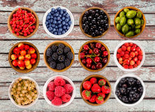 Set various berries. Strawberries, currant, cherry, raspberries, gooseberries and bilberry. Collage of different fruits and berries isolated on white. Ripe and Stock Photo