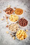 Various breakfast cereal. Set of various breakfast cereal corn flakes, puffs, pops, grey stone table copy space stock photo