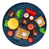 Set of various desserts in stone plate, isolated Royalty Free Stock Images