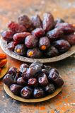 Set of various of dried dates or kurma. In a vintage plates Royalty Free Stock Photography