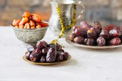 Set of various of dried dates or kurma. In a vintage plates Stock Photo