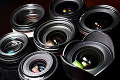 Set of various DSLR lenses with colorful reflections. Shot from above vector illustration