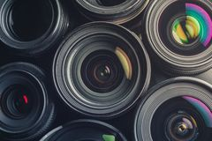 Set of various DSLR lenses with colorful reflections. Shot from above royalty free illustration