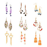 Set of various earrings isolated on white Royalty Free Stock Photography