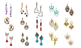 Set of various earrings isolated on white Royalty Free Stock Images