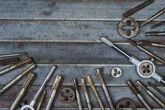 Set of various equipment for threading with copy space, carpente. R tool old rusty metal background Royalty Free Stock Photo