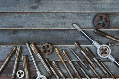 Set of various equipment for threading with copy space, carpente. R tool old rusty metal background Royalty Free Stock Images