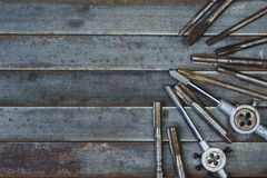 Set of various equipment for threading with copy space, carpente. R tool old rusty metal background Royalty Free Stock Photos