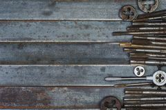 Set of various equipment for threading with copy space, carpente. R tool old rusty metal background Stock Photos
