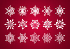 Set of Various Fine Lace Snowflakes for Christmas. On Deep Red Background Stock Image