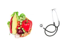 Set of various fresh vegetables, fruits and stethoscope isolated on white Stock Photos