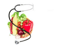 Set of various fresh vegetables, fruits and stethoscope isolated on white Royalty Free Stock Photo