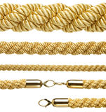 Set of various gold ropes isolated on white Royalty Free Stock Photography