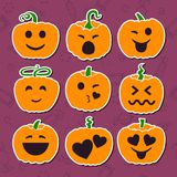 Set of various Halloween pumpkins on purple backgrounds. Emoji cartoon pumpkins. A set of emotional smiles to Halloween. Isolated on purple background. Vector Royalty Free Illustration