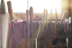 Set of various handyman tools. With sunflare coming through the window Royalty Free Stock Images