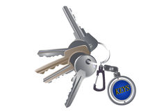 Set of various keys on a charm Royalty Free Stock Photos