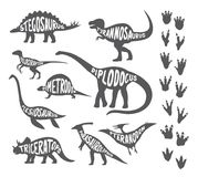 Set with various kinds of painted dinosaurs and footprints. Traces of their legs on white background Royalty Free Stock Photography