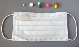 Set of various medical pills and mask Stock Photos