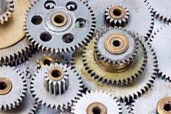 Set of various metal grey cogwheels on industrial background Royalty Free Stock Images